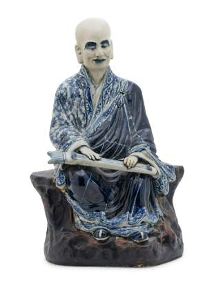 A Chinese Blue and White Ceramic Figure of a Luohan