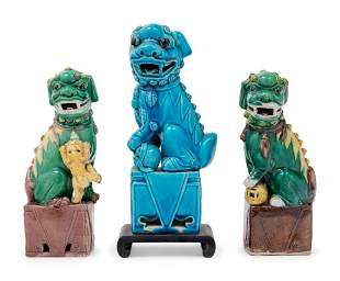 Three Chinese Porcelain Figures of Fu Lions
