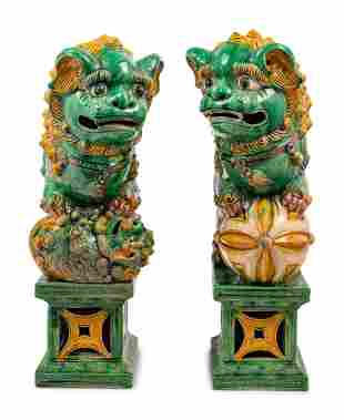 A Pair of Chinese Sancai Glazed Porcelain Figures of Fu