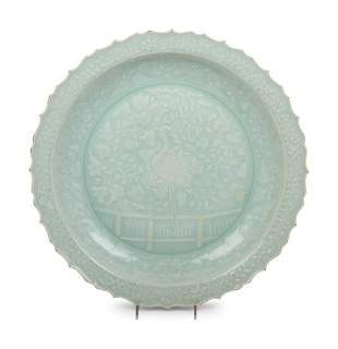 A Chinese Molded Celadon Glazed Porcelain Charger