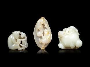 Three Chinese Celadon Jade Carvings of Monkeys