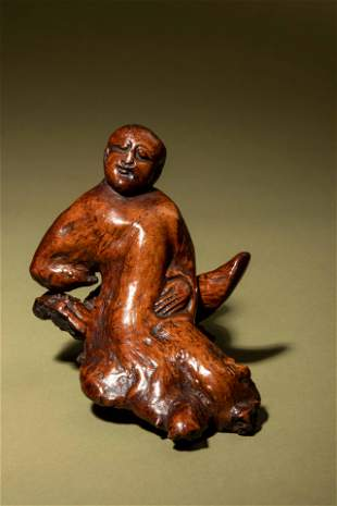 A Chinese Carved Root Figure of a Reclining Man and