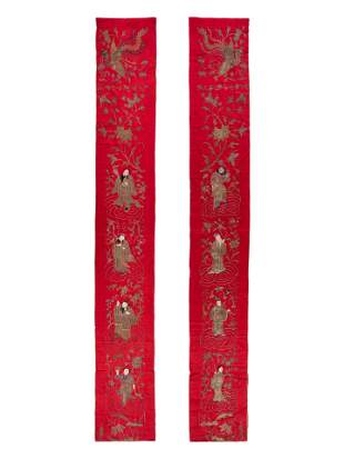 A Pair of Chinese Red Ground Embroidered Silk Panels