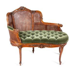 A Louis XV Style Caned Settee height 33 1/2 x width 40