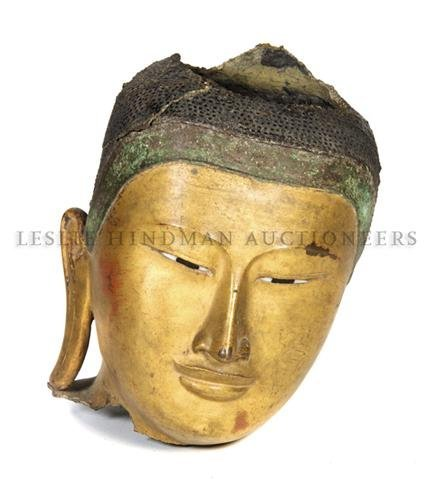 230: A Gilt and Patinated Bronze Head of Buddha, Height