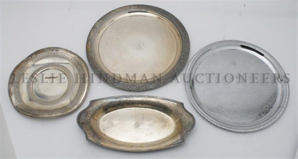 A Collection of Seven Silverplate Trays, Width of wides