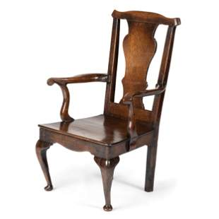 A Queen Anne Volute Carved Oak Open Armchair