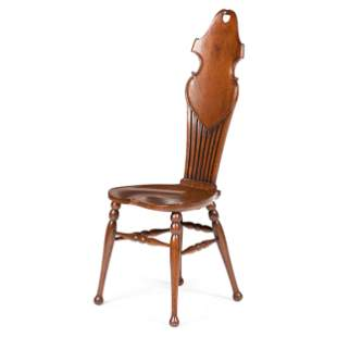 An English Carved and Pierced Oak High-Back Chair