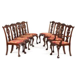 A Set of Eight Chippendale-Style Carved Mahogany Dining