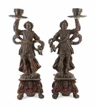 Two Neapolitan Carved and Painted Figural Pricket
