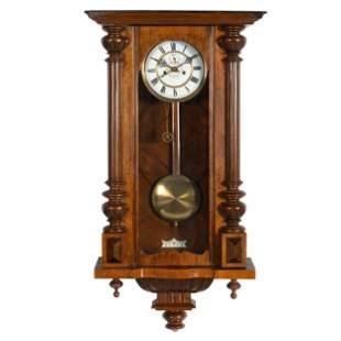 A German Mahogany Veneered Wall Clock