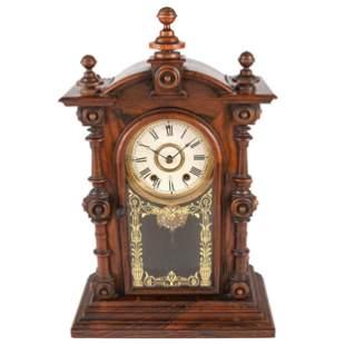 A Carved Rosewood Welch 'Patti VP' Shelf Clock