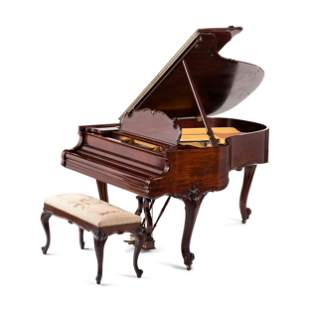 A Steinway and Sons Louis XV Style Walnut Grand Piano