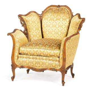A Victorian Silk Upholstered Carved Walnut Armchair