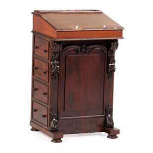 A Victorian Carved Mahogany Davenport Desk