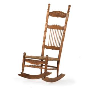A Carved Rocking Chair in Oak with Grotesque Mask to