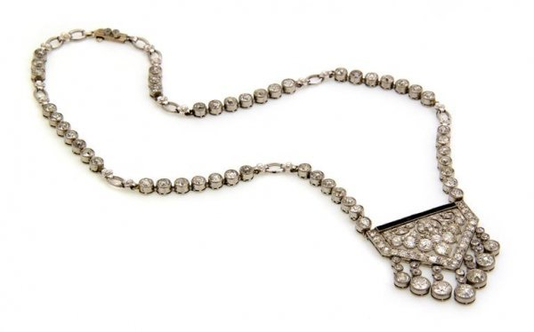 An Art Deco Platinum, Diamond and Onyx Necklace, 21.30