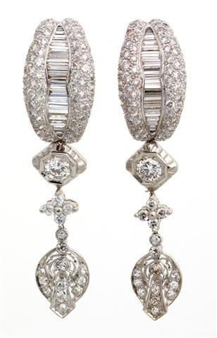 A Pair of 18 Karat White Gold and Diamond Earclips, 12.