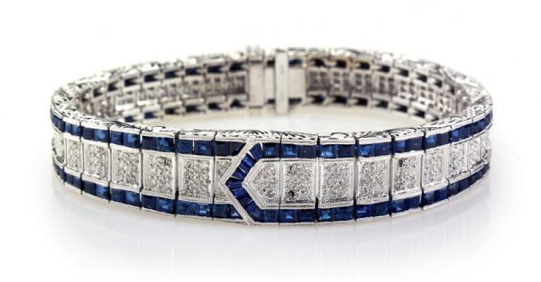 An 18 Karat White Gold, Sapphire and Diamond Bracelet i