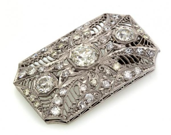 A Platinum and Diamond Pendant/Brooch, 5.50 dwts.