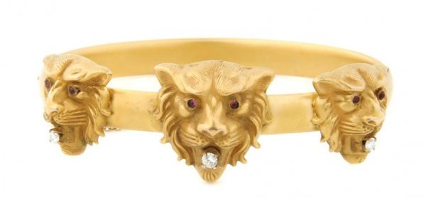 A 14 Karat Yellow Gold and Diamond Hinged Cuff Bracelet