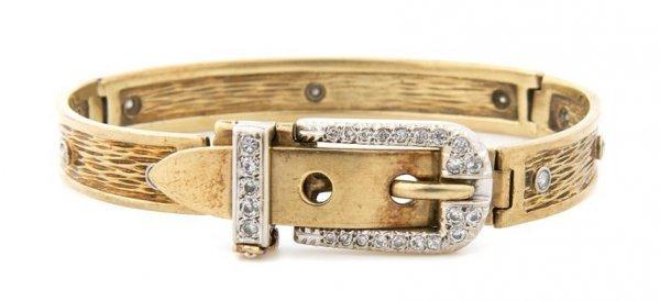 An 18 Karat Yellow Gold and Diamond Bracelet with Buckl