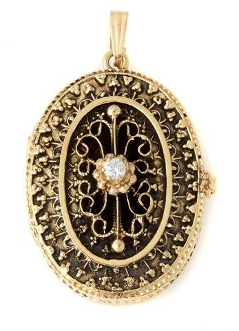 A 14 Karat Yellow Gold and Diamond Locket, 11.80 dwts.