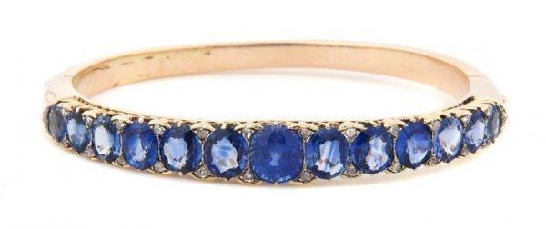 A 14 Karat Yellow Gold, Sapphire and Diamond Bangle Bra