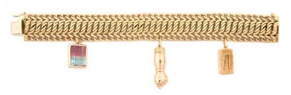 An 18 Karat Yellow Gold Mesh Bracelet with Three Attach