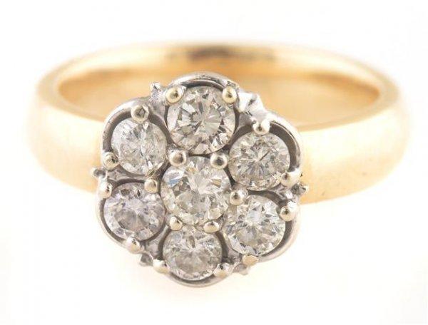 A 14 Karat Yellow Gold and Diamond Ring, 3.91 dwts.