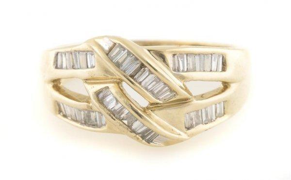 A 14 Karat Yellow Gold and Diamond Ring, 3.67 dwts.