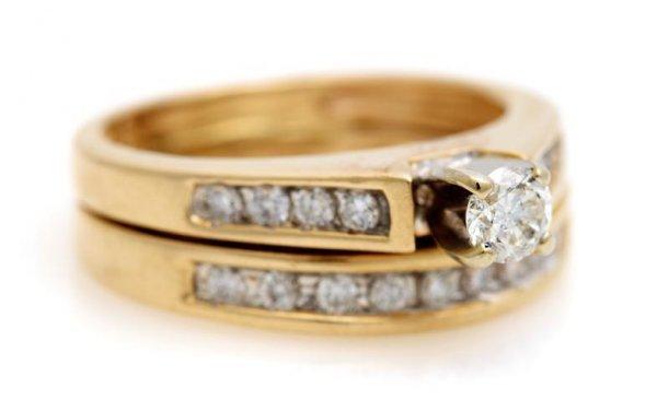 A 14 Karat Yellow Gold and Diamond Ring, 3.20 dwts.