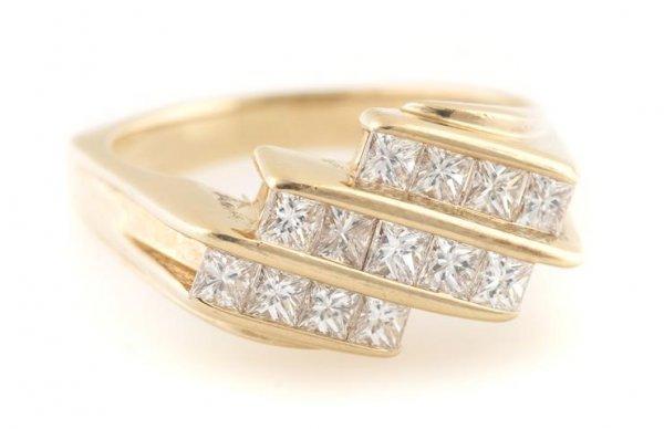 A 14 Karat Yellow Gold and Diamond Ring, 4.31 dwts.