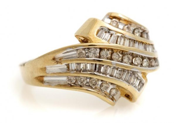 A 10 Karat Yellow Gold and Diamond Ring, 3.17 dwts.