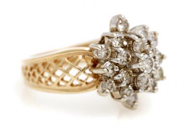 A 14 Karat Yellow Gold and Diamond Ring, 4.04 dwts.