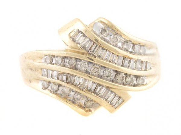 A 10 Karat Yellow Gold and Diamond Ring, 3.38 dwts.