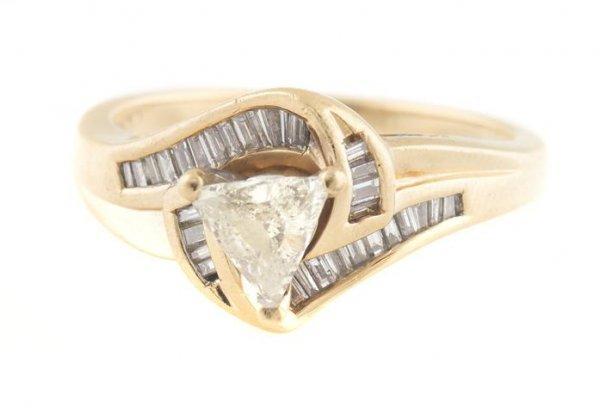 A 14 Karat Yellow Gold and Diamond Ring, 2.68 dwts.