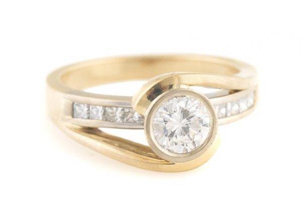 A 14 Karat Yellow Gold and Diamond Ring, 4.22 dwts.