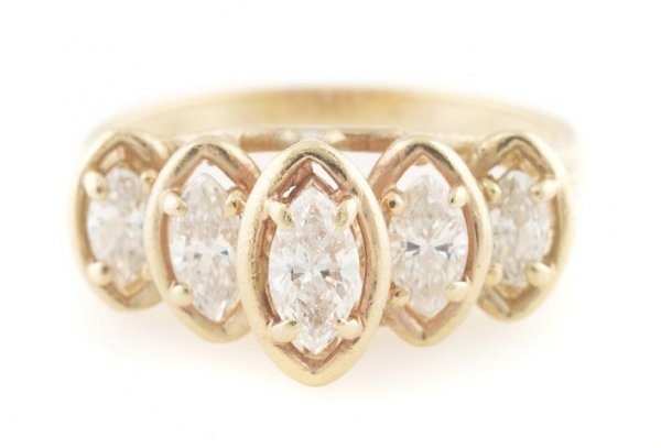 A 14 Karat Yellow Gold and Diamond Ring, 2.44 dwts.