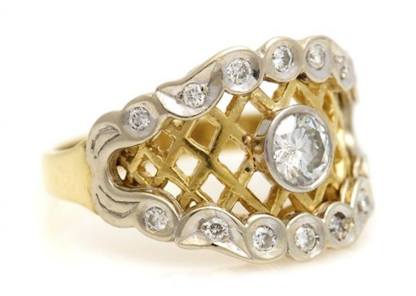 An 18 Karat Yellow and White Gold and Diamond Ring, 4.4