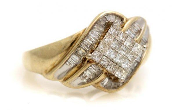 A 10 Karat Yellow Gold and Diamond Ring, 4.41 dwts.