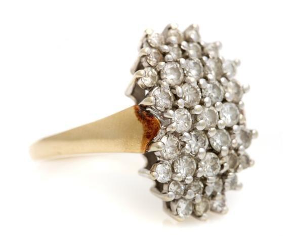 A 14 Karat Yellow Gold and Diamond Ring, 5.74 dwts.