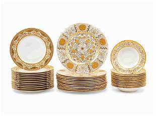 Three Sets of Gilt Decorated Porcelain Plates