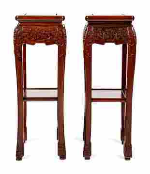 A Pair of Chinese Carved Hardwood Pedestals