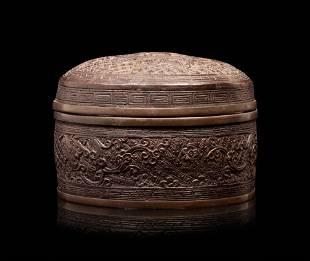 A Bronze Circular Box and Cover
