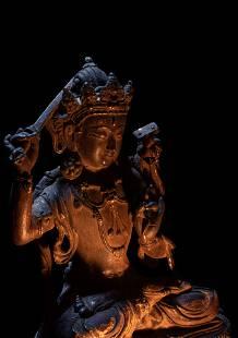A Sino-Tibetan Parcel-Gilt Bronze Figure of Manjushri
