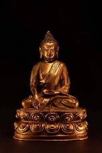 A Small Sino-Tibetan Gilt Bronze Figure of Seated