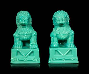 A Pair of Chinese Molded Glass Figures of Fu Lions