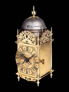 A English Brass Lantern Clock, with Iron Bracket,