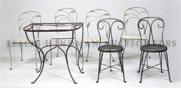 A Set of Four Cast Metal Garden Chairs, Height of first